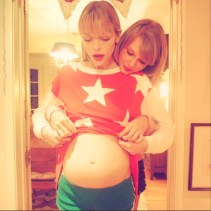 taylor's going to be a godmother!! <333