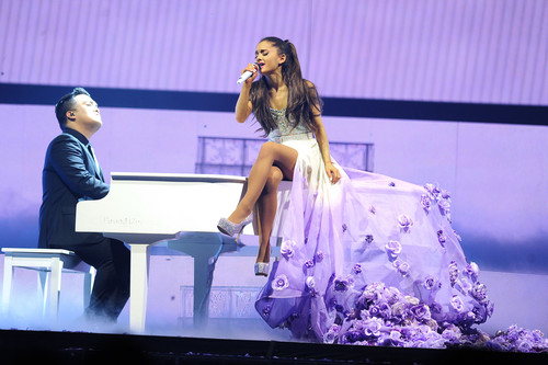 Ariana Grande karatasi la kupamba ukuta probably containing a chajio, chakula cha jioni dress and a bridesmaid called Ariana performing at her Honeymoon Tour *-*