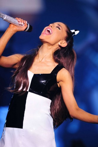 ariana grande wallpaper probably with a coquetel dress titled Ariana performing at her Honeymoon Tour *-*