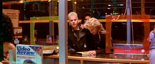 The Lost Boys Movie kertas dinding possibly with a tobacco shop, a revolving door, and a bodega called At the Video Store