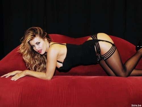 Carmen Electra wallpaper possibly containing a leotard, a bustier, and a couch titled Carmen