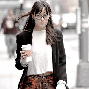 Dakota Johnson walks around town with some vrienden on Friday (April 10) in New York City.