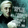 Harry Potter photo with a sign titled Draco Malfoy