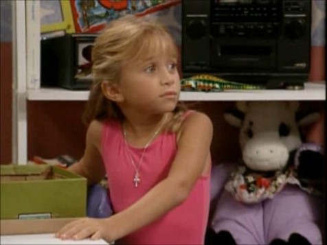 Full House wallpaper probably with a sign entitled Michelle Tanner at the Age of Eight