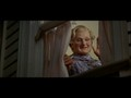 Mrs. Doubtfire smiling and waving to Stu