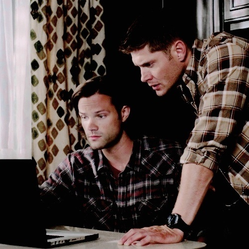 The Winchesters वॉलपेपर possibly containing a sign titled Sam and Dean