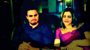 Stephen Amell and Emily Bett Rickards wallpaper