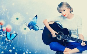 Taylor with guitarra