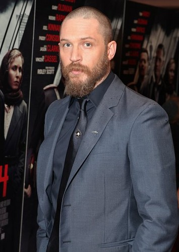Tom Hardy wallpaper containing a business suit, a suit, and a three piece suit called Tom Hardy attending the UK premiere of Child 44 at Vue West End, London.