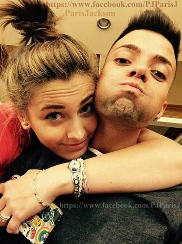 Paris Jackson kertas dinding possibly with a bouquet, a sign, and a portrait entitled paris jackson with omer bhatti