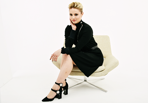 Dianna Agron wallpaper possibly containing a well dressed person, an outerwear, and a hip boot called                              Dianna Agron