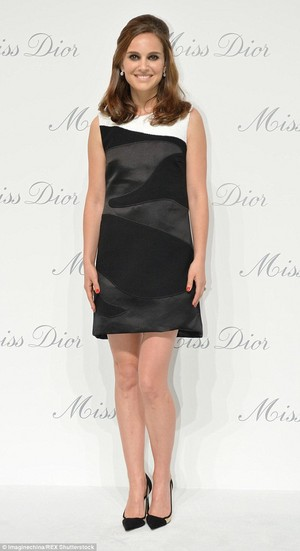 Attending the opening of a Miss Dior exhibition in Beijing, China (April 29th 2015)