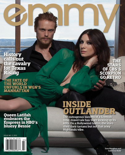 2014년 TV 시리즈 아웃랜더 바탕화면 containing a sign and a leisure wear called Caitriona Balfe and Sam Heughan on Emmy Magazine Cover