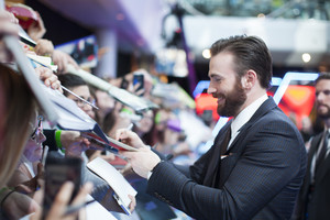 Chris Evans signing autographs Red Carpet at Avengers Age of Ultron UK Premiere