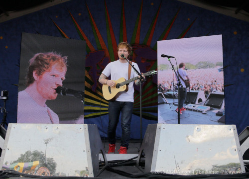 Ed Sheeran wallpaper with a concert and a guitarist titled Ed at the New Orleans Jazz Fest