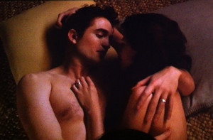 Edward and Bella touching each other
