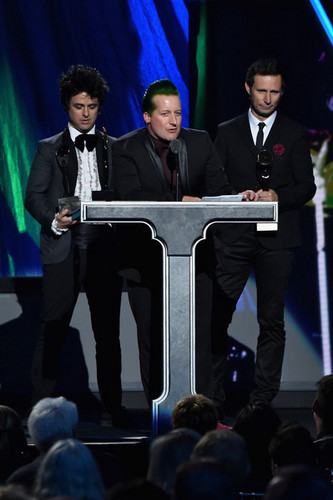 Green Day wallpaper with a business suit, a concert, and a pianist titled Green Day Speaking @ the 30th Annual Rock And Roll Hall Of Fame Induction Ceremony