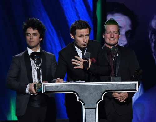 Green Day wallpaper probably containing a business suit called Green Day Speaking @ the 30th Annual Rock And Roll Hall Of Fame Induction Ceremony