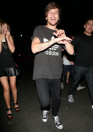 Louis attending Snoop Dog's album release party