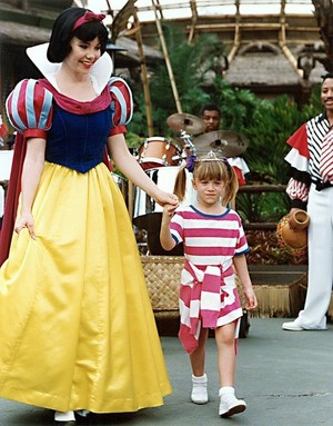Michelle being escorted by Snow White