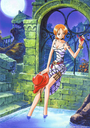 Nami standing in water holding a hat