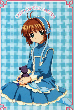 Sakura sits with a plush toy