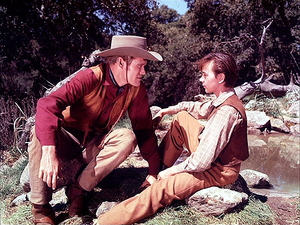 Chuck Connors as Burn Sanderson and Tommy Kirk as Travis Coates in Old Yeller