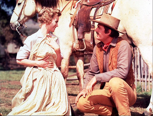 Dorothy McGuire as Katie Coates and Fess Parker as Jim Coates in Old Yeller