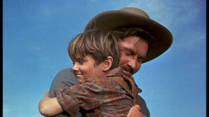 Fess Parker as Jim Coates and Kevin Corcoran as Arliss Coates in Old Yeller