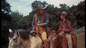 Fess Parker as Jim Coates and Tommy Kirk as Travis Coates in Old Yeller