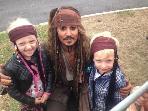 Johnny Depp wallpaper entitled Johnny meets little fans on set of POTC 5 (June 2015)