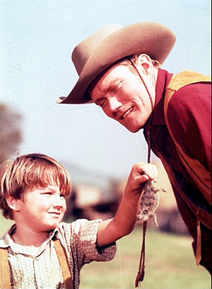 Kevin Corcoran as Arliss Coates and Chuck Connors as Burn Sanderson in Old Yeller