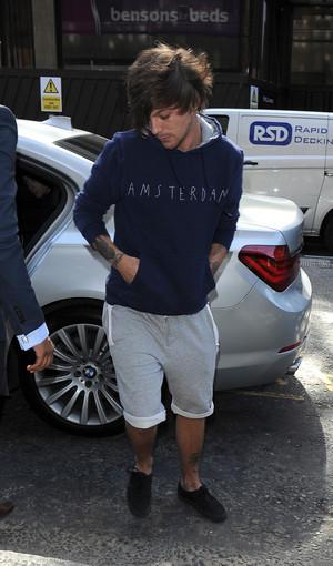 Louis leaving Sony muziki offices in London