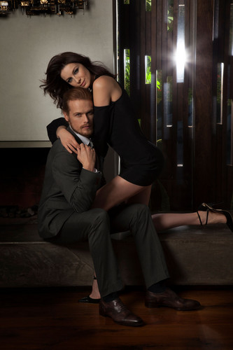 Outlander 2014 TV Series پیپر وال with a business suit, a well dressed person, and a family room titled Sam Heughan and Caitriona Balfe in Emmy Magazine Photoshoot