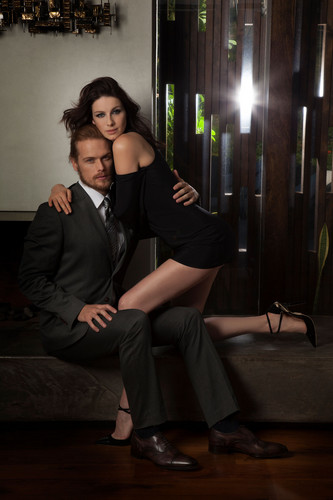 Outlander 2014 TV Series پیپر وال with a business suit, a suit, and a well dressed person titled Sam Heughan and Caitriona Balfe in Emmy Magazine Photoshoot