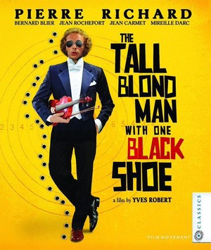 The tall blond man wtih one black shoe