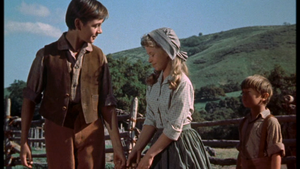 Tommy Kirk as Travis Coates and Beverly Washburn as Lisbeth Searcy in Old Yeller
