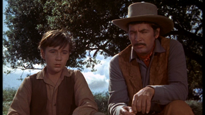 Tommy Kirk as Travis Coates and Fess Parker as Jim Coates in Old Yeller
