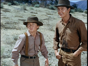 Tommy Kirk as Travis Coates and Kevin Corcoran as Arliss Coates in Savage Sam