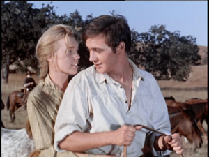 Tommy Kirk as Travis Coates and Marta Kristen as Lisbeth Searcy in Savage Sam
