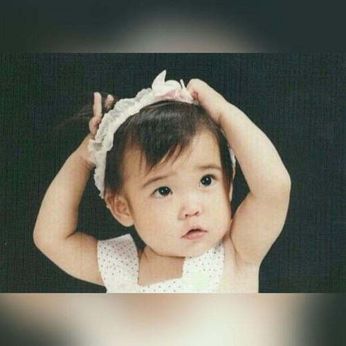 iu wallpaper possibly with a bonnet entitled 150716 IU childhood foto has been revealed!