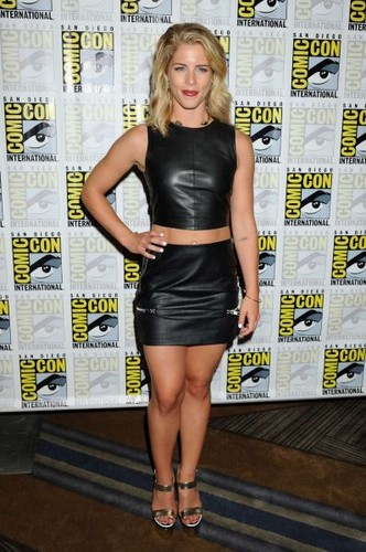 Emily Bett Rickards wallpaper probably with bare legs, a hip boot, and tights entitled 2015 Comic-Con 'Arrow' Press Room - July 11, 2015