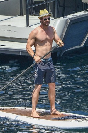 Chris Hemsworth paddle boarding in Corsica 4th of July 2015