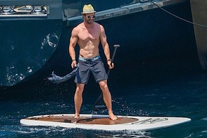 Chris Hemsworth paddle boarding in Corsica during 4th of July weekend 2015