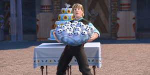 Kristoff holding a bowl of snowgies