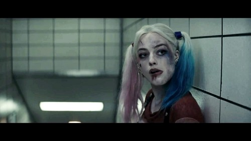 Harley Quinn wallpaper possibly with a sign entitled Margot Robbie as Harley Quinn in the First Trailer for 'Suicide Squad'