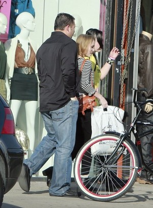 Shopping with a friend in West Hollywood, California on February 3, 2013