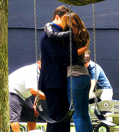 Nathan Fillion & Stana Katic wallpaper containing a swing titled Stanathan-BTS at the swings