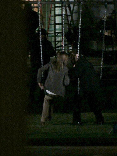 Nathan Fillion & Stana Katic wallpaper possibly containing a swing entitled Stanathan-BTS at the swings