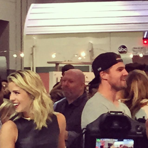 Stephen Amell & Emily Bett Rickards wallpaper probably containing a commensale, diner called Stephen Amell and Emily Bett Rickards signing autographs at SDCC 2015.